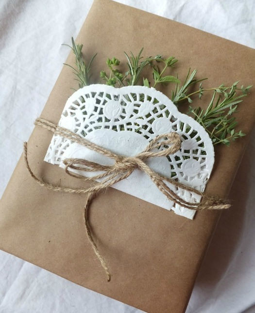 doily gift wrap with fresh herbs and twine - simple kraft paper gift wrap idea