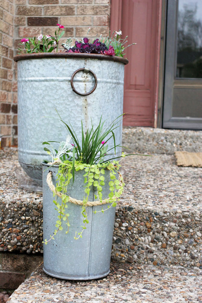Learn how to make a DIY Pail Planter from an old metal bucket. Give your front porch vintage, farmhouse style with easy pail planters.