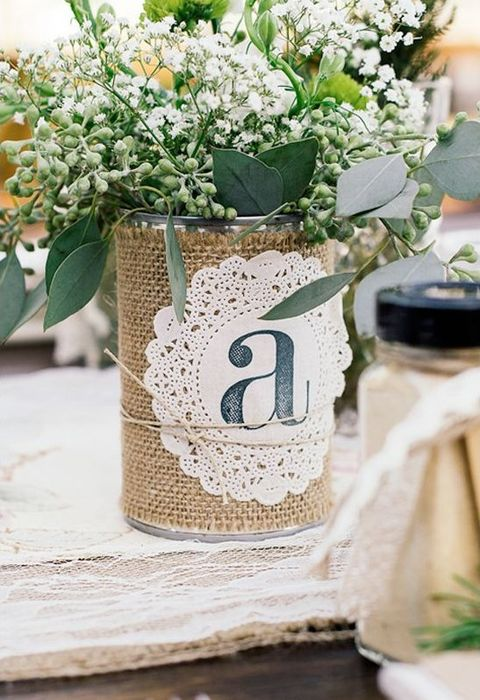 Rustic paper doily and burlap tin can centerpiece