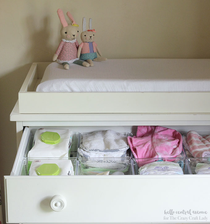 Find out below how to take your drawers from messy to magnificent! Inspiring nursery dresser organization with dollar store supplies.