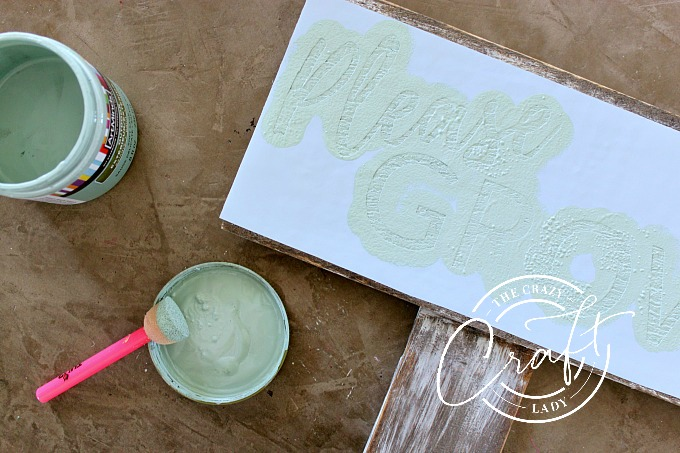 Painting a garden sign with a stencil
