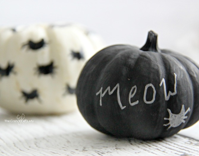 Decorate mini pumpkins for Halloween with paint markers and chalk paint.