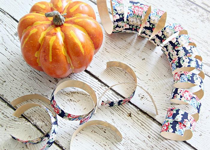 cover mini pumpkins in fabric tape