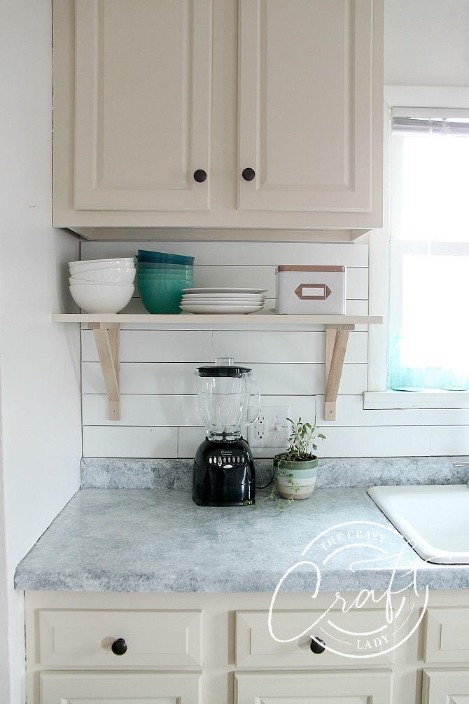 cottage kitchen cabinets and shiplap backsplash