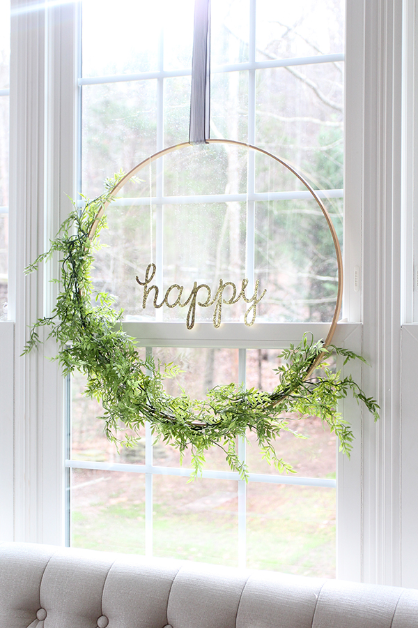 "Floral ""happy"" Hoop Wreath - Get inspired to make your very own hula hoop wreath with one of these 8 gorgeous giant hoop wreaths. Add some fun to your home or party decor."
