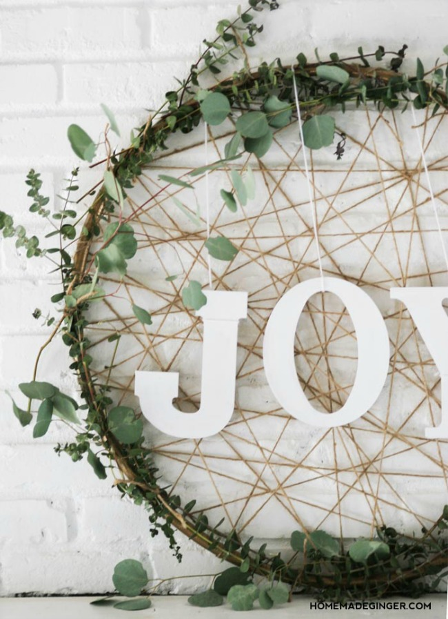 Giant DIY JOY Wreath - Get inspired to make your very own hula hoop wreath with one of these 8 gorgeous giant hoop wreaths. Add some fun to your home or party decor.