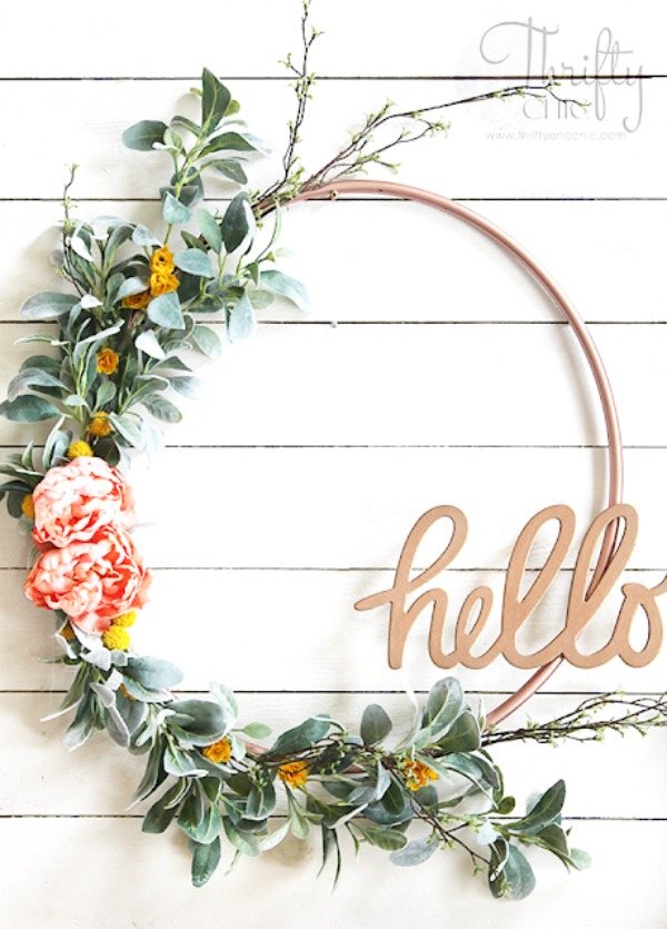 "Spring ""hello"" Hula Hoop Wreath - Get inspired to make your very own hula hoop wreath with one of these 8 gorgeous giant hoop wreaths. Add some fun to your home or party decor."