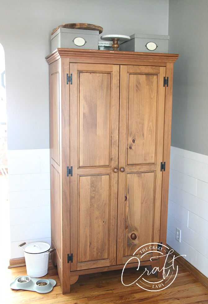 antique wardrobe used as extra dining room storage