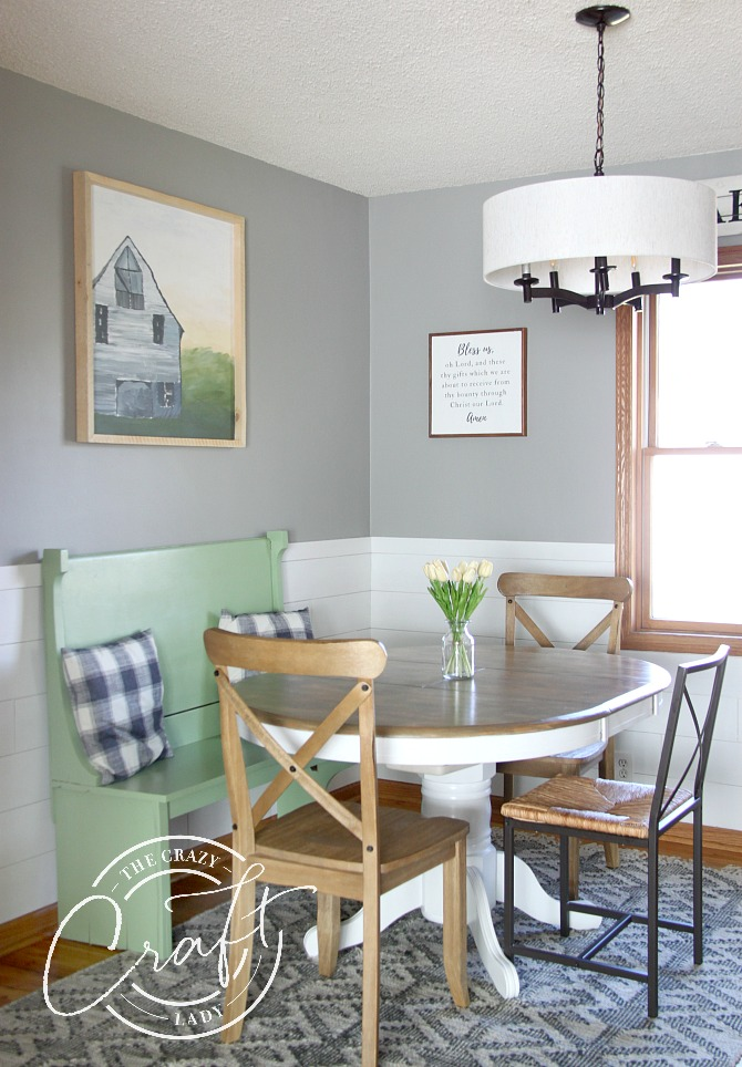 cozy dining area with reclaimed church bench for seating