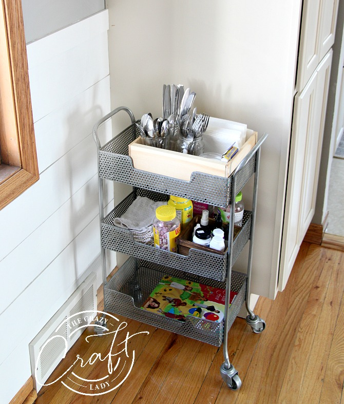 family mealtime essentials organized on a small dining room cart