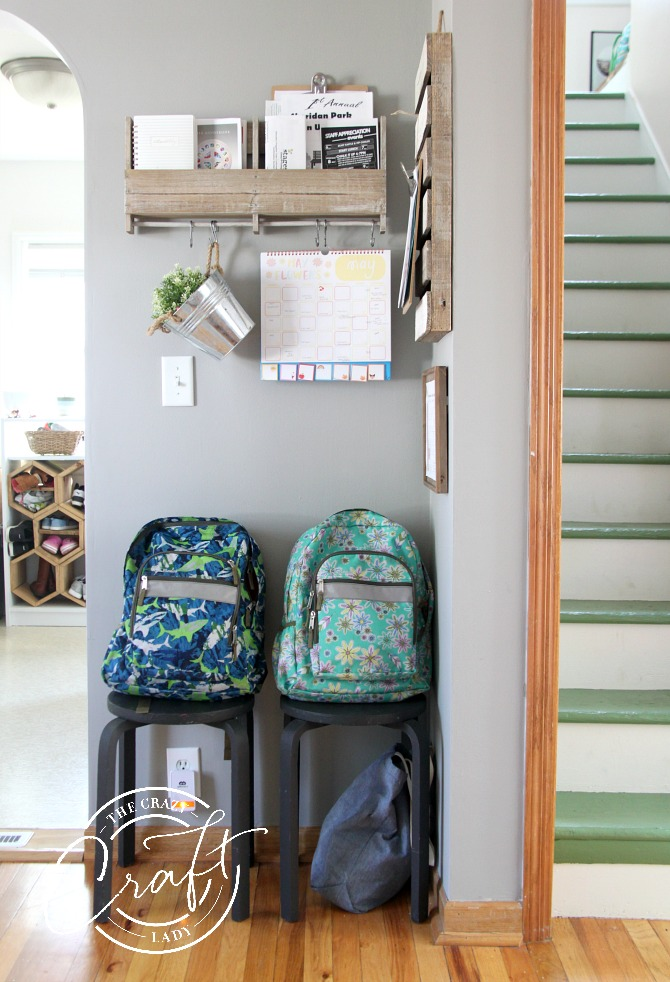 organizing backpacks and school calendars in a corner family command center