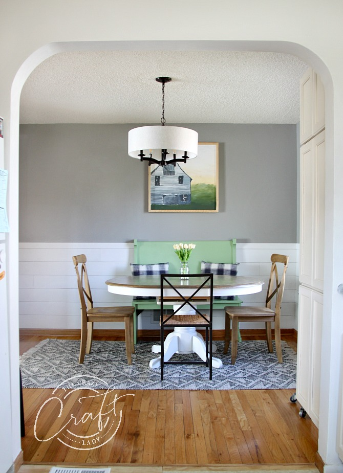 view from kitchen into neutral farmhouse dining room