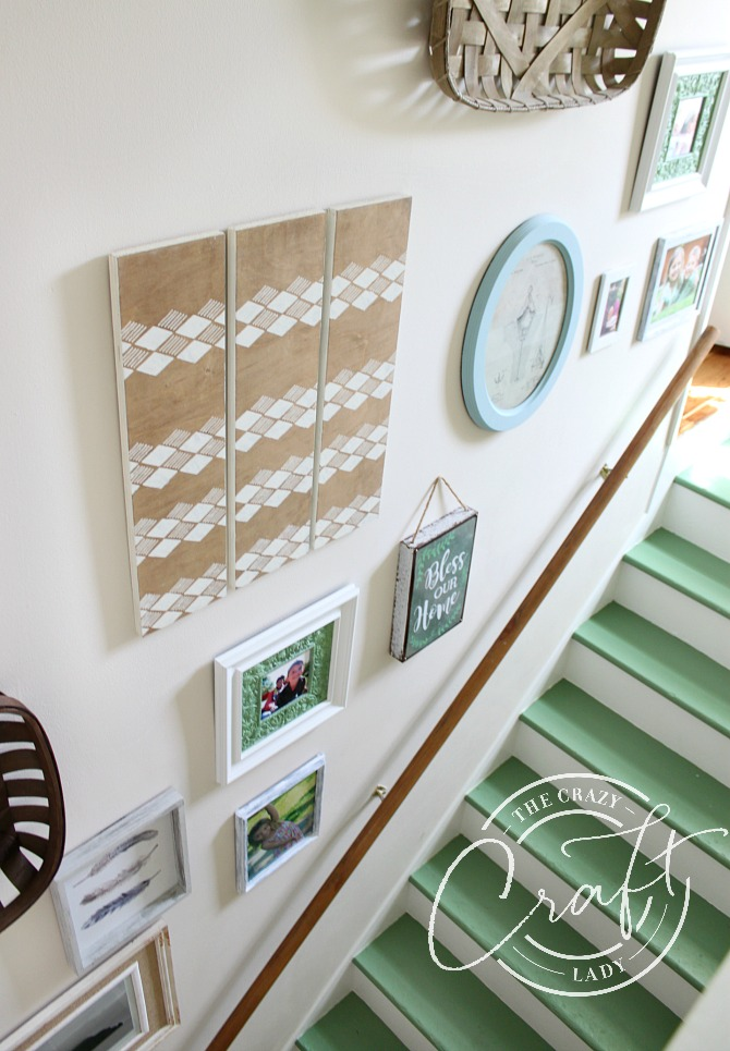 Green stairs and neutral gallery wall