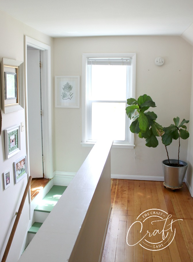 Neutral farmhouse hallway at the top of stairs