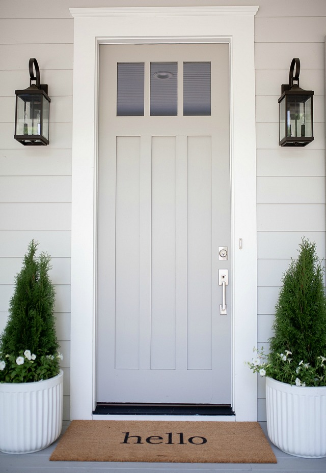 siding painted in Sherwin Williams Repose Gray - front door painted with Sherwin Williams Dorian Gray - exterior trim painted in Sherwin Williams Alabaster White