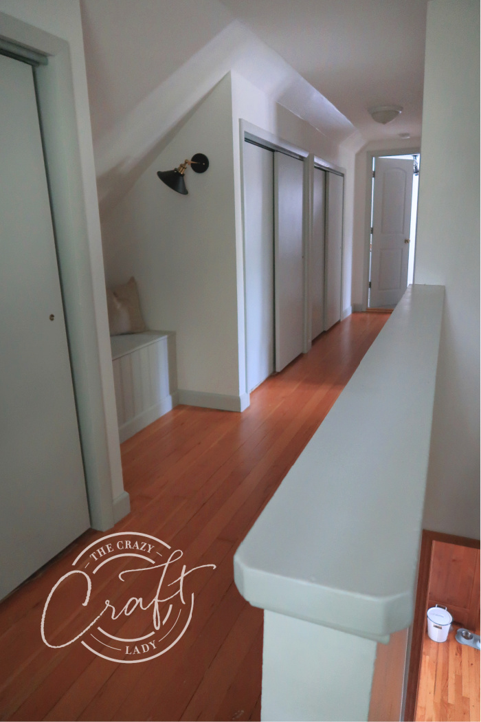 upstairs hall with gray doors, gray baseboards, and white walls