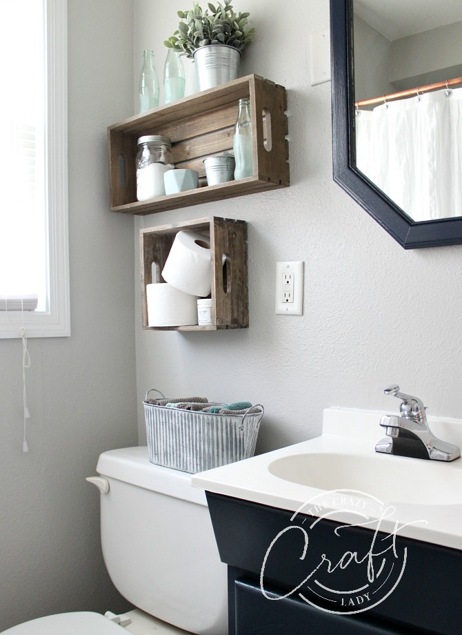 Small bathroom update with repose gray walls and naval painted vanity