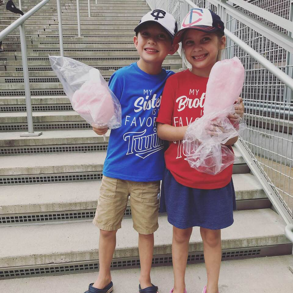 Twin siblings at a MN Twins baseball game