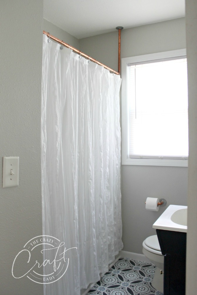 modern farmhouse bathroom with copper pipe shower curtain rod