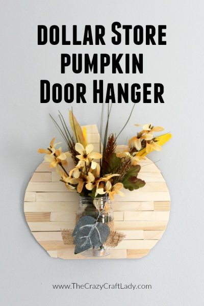 Grab a few Dollar Tree supplies and wooden craft sticks to make this dollar store pumpkin door hanger just in time to decorate for fall.