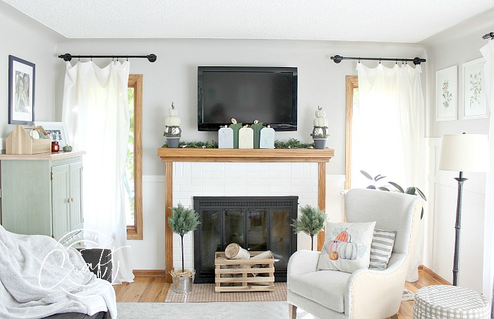 Neutral farmhouse style fall living room - Farmhouse style fall pumpkin crafts from scrap wood and dollar store supplies.