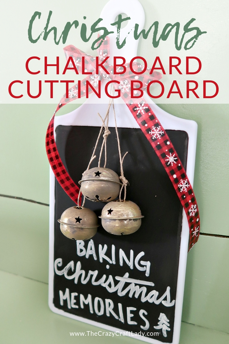 Transform a basic dollar store cutting board with a few simple craft supplies and make this Christmas chalkboard cutting board with buffalo check ribbon and holiday bells.
