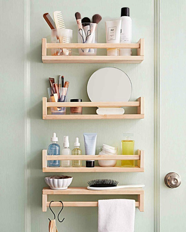 Ikea hack spice rack for bathroom wall storage - Take the spice racks out of your kitchen, and mount them in your bathroom for handy storage. The shelves hold beauty essentials, while one inverted shelf serves as a makeshift towel bar and necklace holder.
