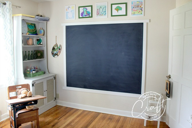 Kids Playroom Artroom with giant navy blue chalkboard wall