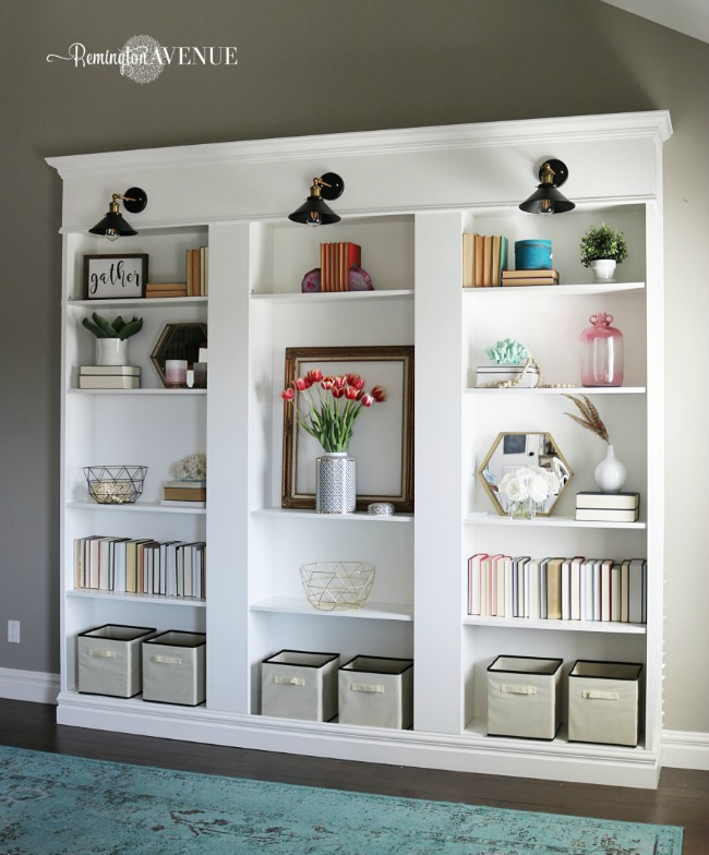 custom built-in billy library bookcase with sconce lighting