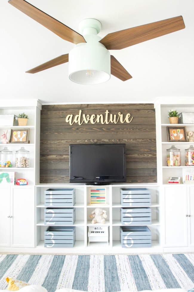 farmhouse style ikea playroom cabinets and open shelving