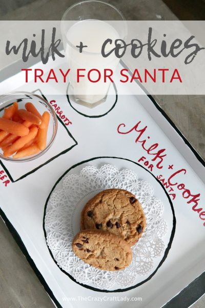 Make this cute farmhouse-style enamel Santa cookie tray with a dollar store cookie sheet and chalk paint. Leave out cookies and milk for Santa and carrots for the reindeer.