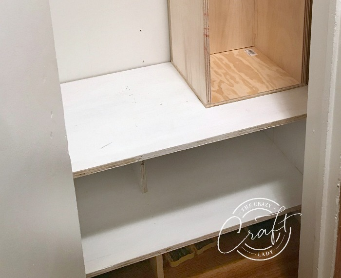 Adding a shelf in the bottom of a hall closet