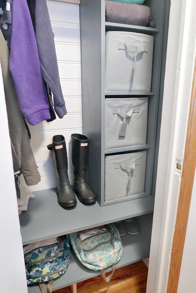 Organized coat closet with DIY cube shelves