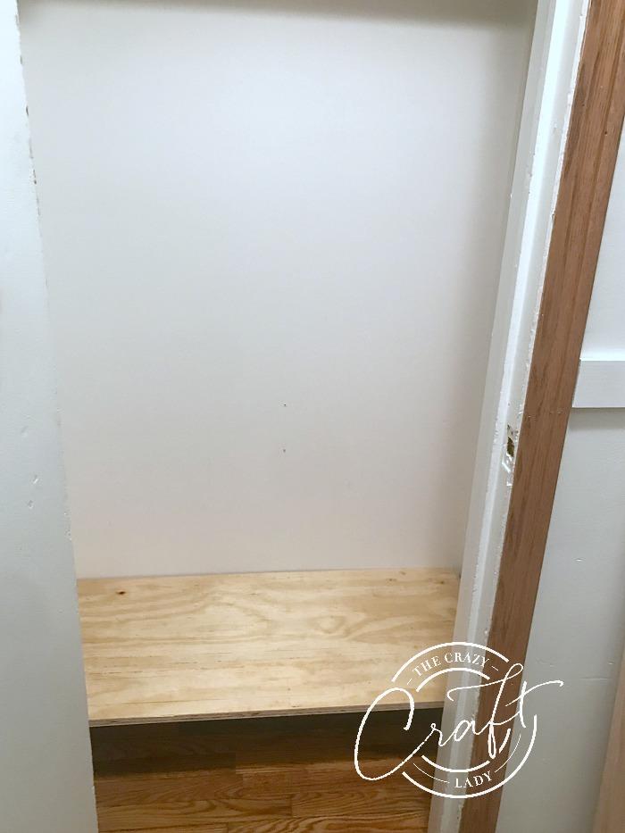adding a shelf to the bottom of a coat closet
