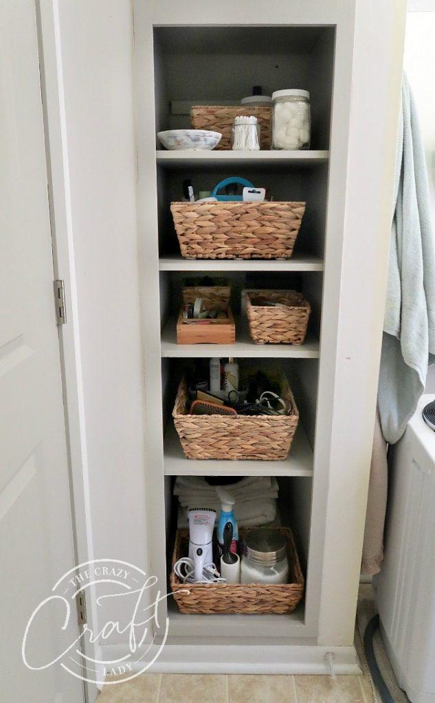 gray bathroom shelves with baskets