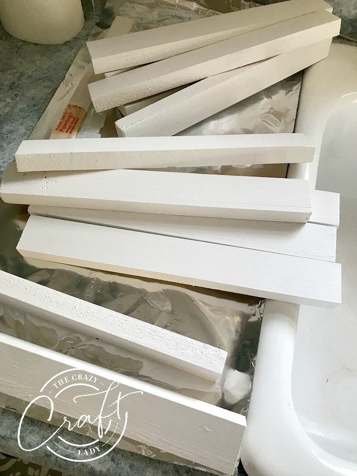 painting wooden cleats for DIY closet shelves