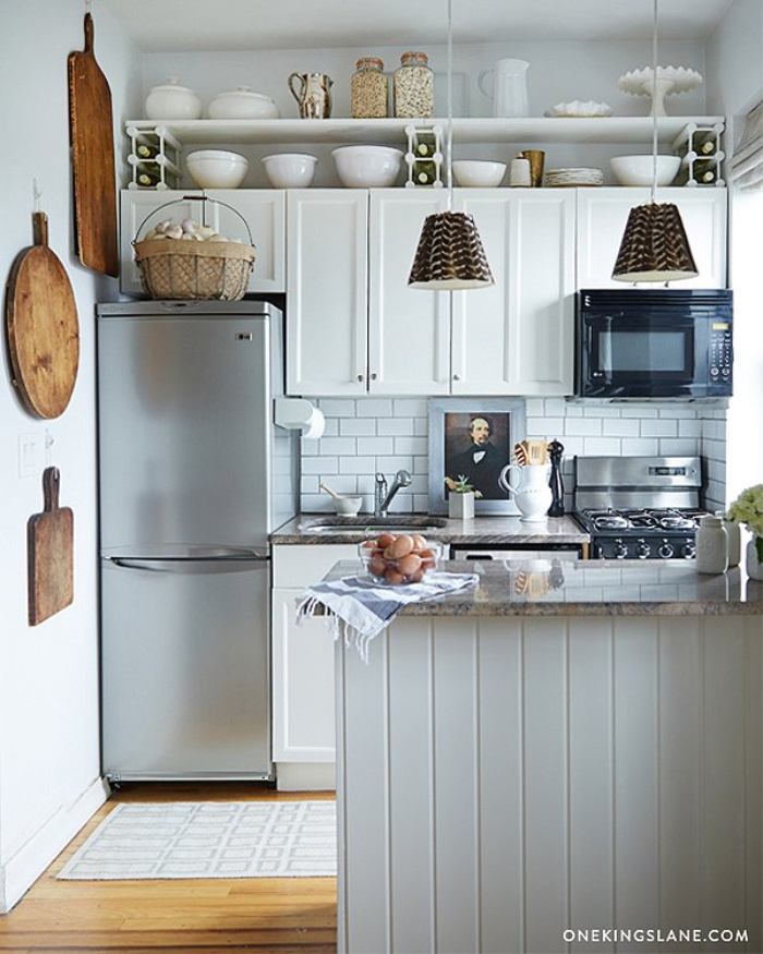 Wine rack shelving above upper kitchen cabinets from One Kings Lane