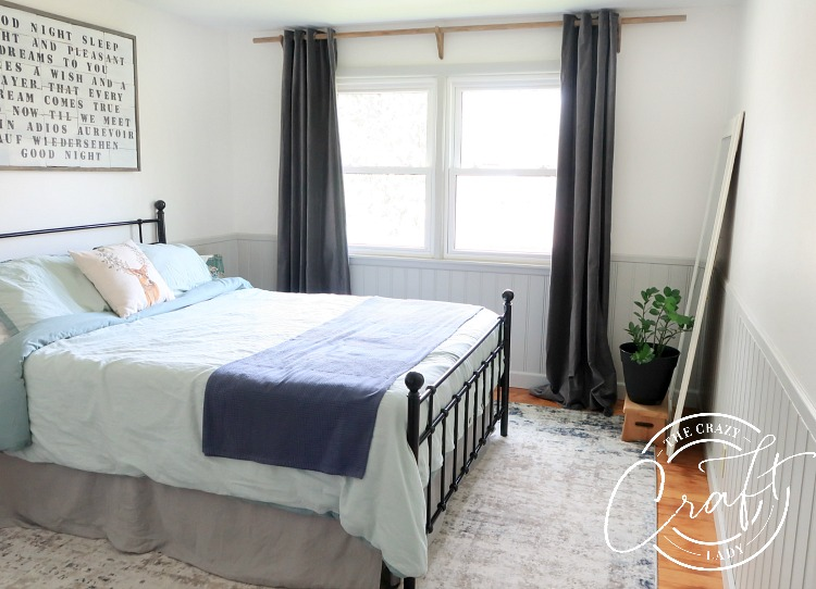 farmhouse bedroom with neutral teal and blue decor