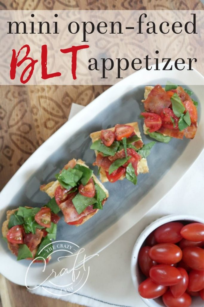 A simple recipe for open-faced BLT crostini with hummus, bacon, spinach, and tomato. This mini BLT sandwich appetizer comes together in a snap and will sure to be a hit with any crowd.