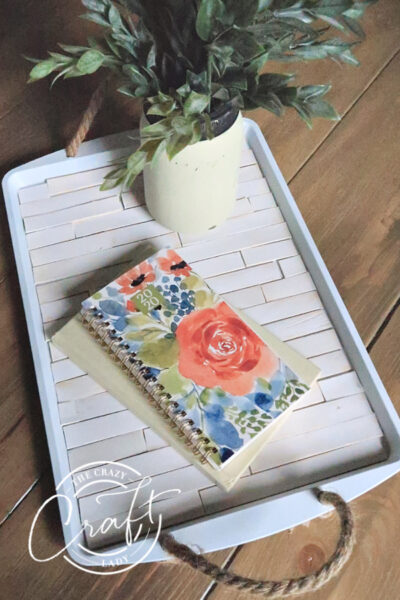 Grab some dollar store supplies to make this DIY cookie sheet serving tray. For just a few dollars, you can make this functional and beautiful farmhouse-style tray.