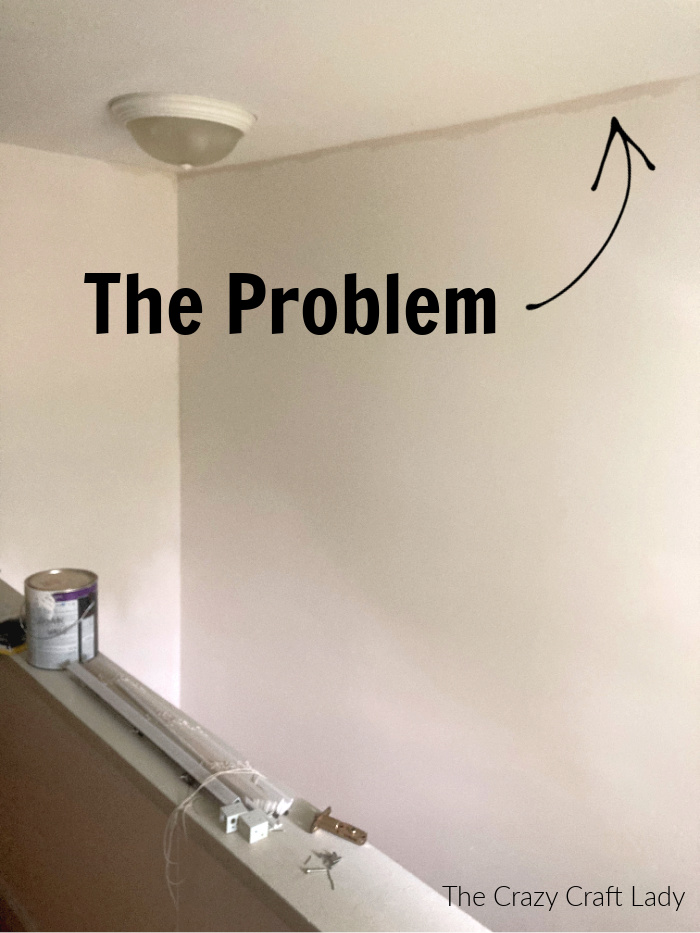 The problem - how to paint the trim on a tall wall