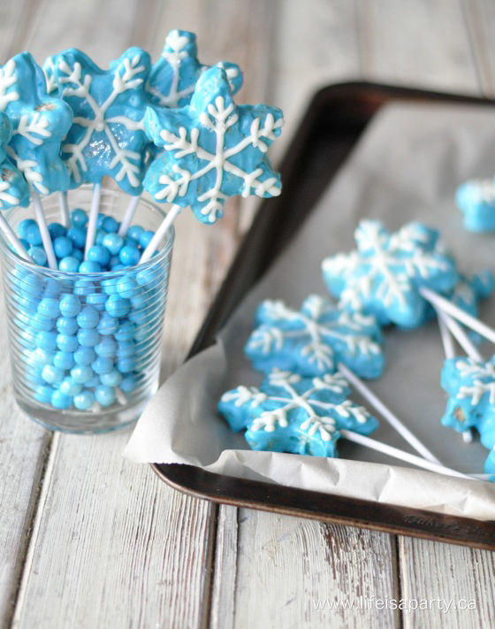 Star-shaped Rice Krispie treats decorated to look like Frozen-inspired snowflakes.