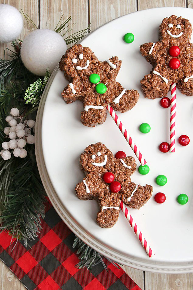 Chocolate gingerbread men Rice Krispie treats decorated with M&Ms.
