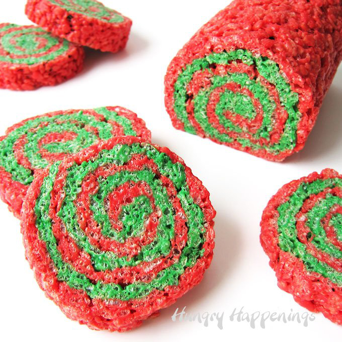 A red and green Rice Krispie treat pinwheel cut into slices.