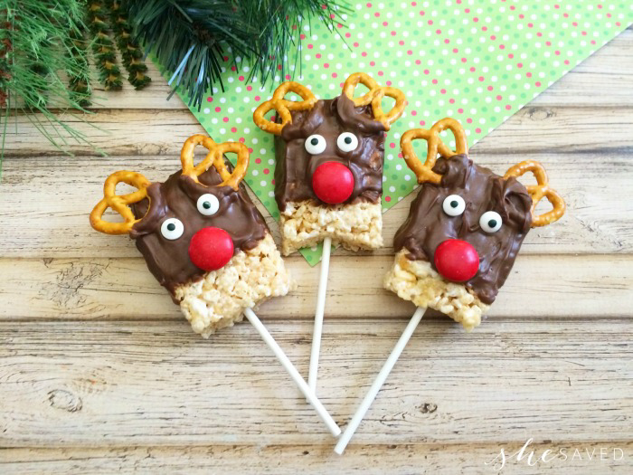 Three reindeer Rice Krispie treats on sticks.