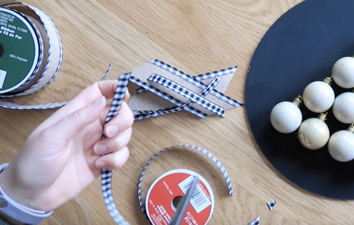 Cut two 4-inch lengths of both the wide and thin ribbon - be sure to cut at a 45-degree angle. Secure the 4 lengths of ribbon together in the center