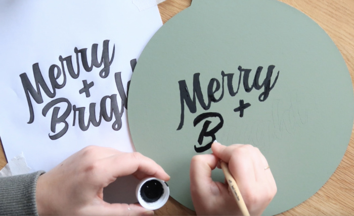 Use a small paint brush to fill in all of the pencil outlines with black paint