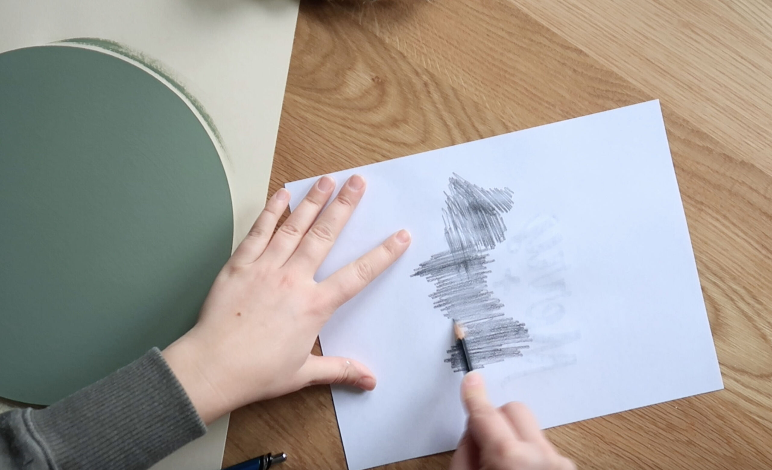 Using a pencil, scribble back and forth across the back of the paper, covering all the parts where the printer had printed ink