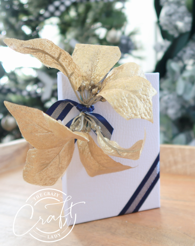 decorate a dollar store gift card box with gold flowers and navy ribbon