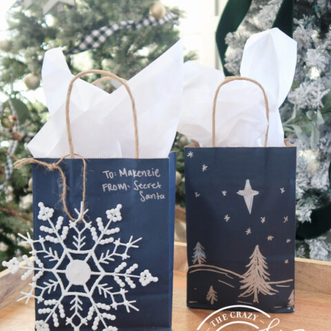 decorated dollar store gift bags with ornaments and silver marker